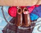 Кожаные тапочки.