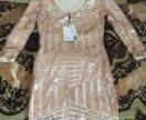 новое платье с небольшим вырезом на спине