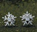 Продам серебряные серьги снежинки