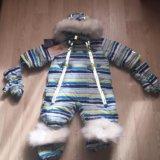 Новый зимний пуховый комбинезон с аксами. Фото 1.