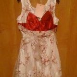 Нарядное белое платье с красным бантом. Фото 2.