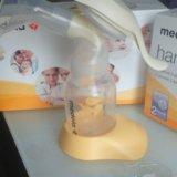 Молокоотсос medela ручной(не пользовались). Фото 2.