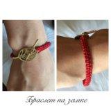 Плетёные браслет из красных нитей от сглаза. Фото 1.