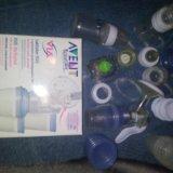Молокоотсос+2 бутылочки+контейнеры для хранения. Фото 1.