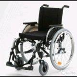 Кресло-коляска для инвалидов. Фото 1.