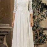 Греческое кружевное свадебное платье с рукавами. Фото 1. Москва.