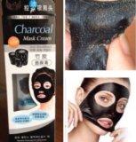 Черные маски. Фото 1.