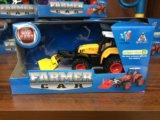Трактор металлический с насадкой инерционный. Фото 1.