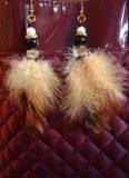 Серьги из перьев ручной работы. Фото 3.