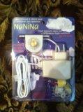 Автоматическое устройство для укачивания кроватки. Фото 1.