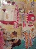 Игрушечная детская кухня с часами. Фото 1.