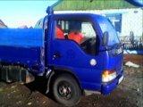 Бортовой грузовик isuzu elf. Фото 2.
