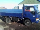 Бортовой грузовик isuzu elf. Фото 3.