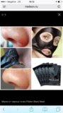 Чёрная маска для лица , карепрост. Фото 1.
