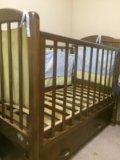 Детская кровать с маятником. Фото 1.
