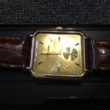 Часы золотые. Фото 1.