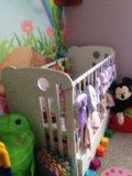 Детская кроватка с маятником. Фото 1.