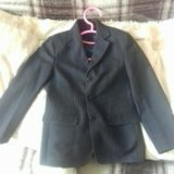 Фирменный пиджак,надевали 2 раза,за год стал мал. Фото 2.
