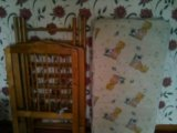 Детская кроватка с матрасом в разобраном виде . Фото 1.