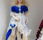 Кукла фарфоровая,