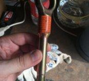 Буксировочный крюк Subaru Impreza.