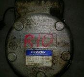 Компрессор кондиционера / кронштейн Rio 1 2004 1.5