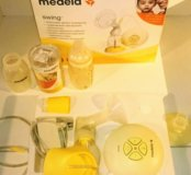Молокоотсос Medela Swing электронный