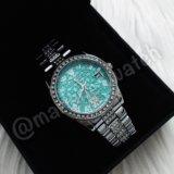 Серебристые часы Rolex
