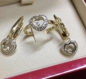 Очень красивый комплект Chopard из золота с брилли