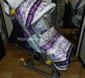 Новые санки коляска