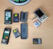 Старые телефоны и фотоаппарат