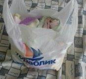 Вещи для малышки пакетом.
