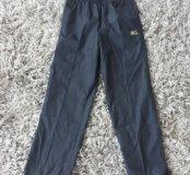 Тонкие спортивные непромокаемые новые штаны