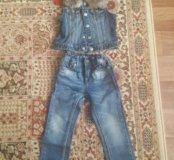 Джинсы и джинсовая жилетка с отстегивающим мехом