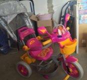 Новый трехколесный велосипед с ручкой розово/желт
