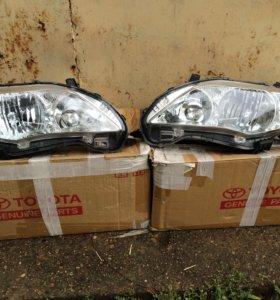 Оригинальные фары Toyota Corolla E150  рестайл.