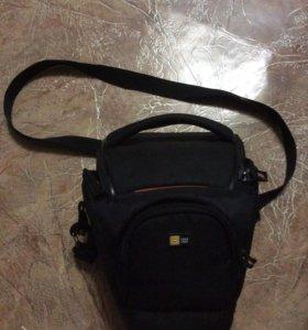 Маленькая сумка для фотоаппарата.