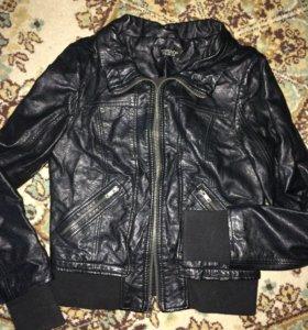 Женская кожаная куртка .