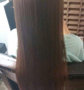 Процедура кератинового восстановления волос.