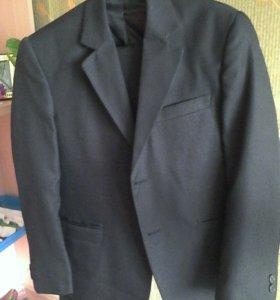 Новый костюм 36 р. +  еще одни брюки