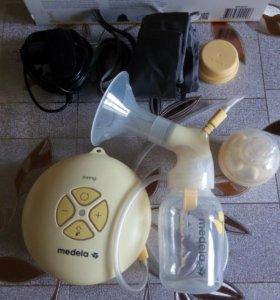 Молокоотсос электронный 2-фазный Medela swing