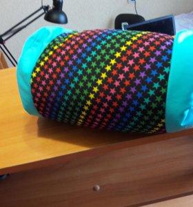 Яркая подушечка с шариками внутри