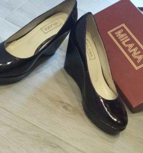 Новые кожанные туфли р.35