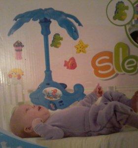 Музыкальная игрушка в кроватку