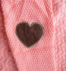 Одежда: свитера.