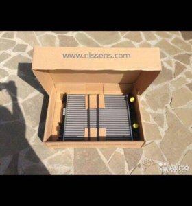 Радиатор охлаждения на Renault Logan