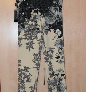 Новые брюки и бусы
