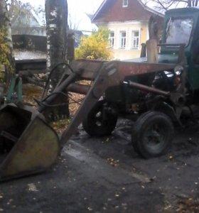 Услуги трактора  с погрузчиком