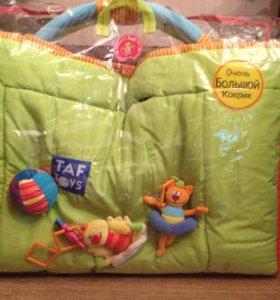 Развивающий коврик TAF Toys с дугами и игрушками