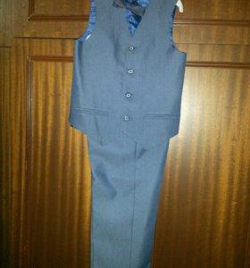Комплект брюки и жилет. Размер 122.